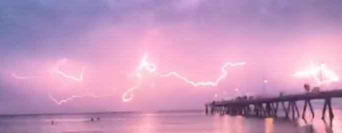 lightning sky pink adelaide australia video, lightning turns sky pink australia, sky turns pink after lightning australia, australia lightning adelaide pink sky, pink sky lightning adelaide