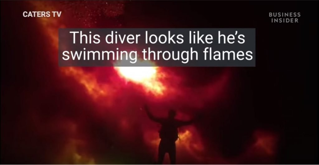 diver swimms in fire florida video