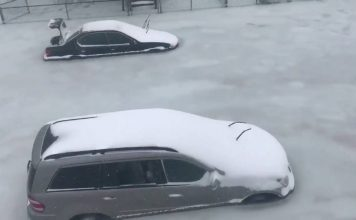 flooding massachusetts, bomb cyclone floos massachusetts freeze, cars trapped in ice after flooding waters freeze in Severe, Massachusetts, Storm surge freezes in Severe, MA, trapping hundreds of cars in ice