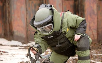 bomb squad officer explosion, bomb squad officer survives explosion video, bomb suit, officer wearing a bomb suit