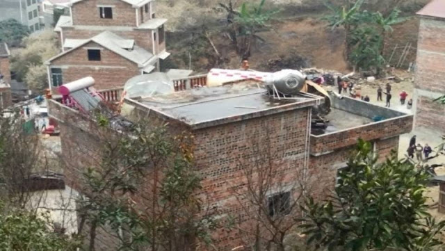 Parts of a rocket fell on homes in China, Parts of a rocket fell on homes in China pictures, Parts of a rocket fell on homes in China february 2018