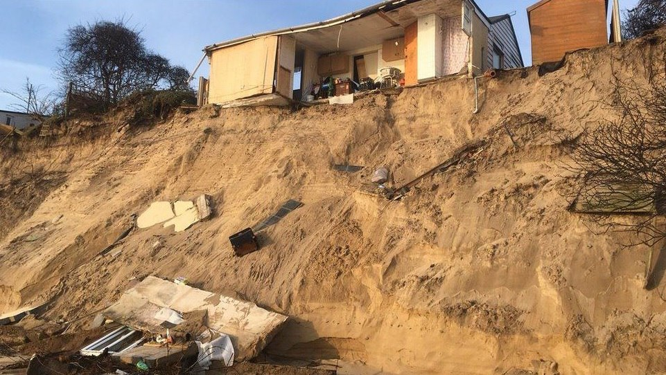 Shocking drone footage of homes falling off cliffs at Hemsby after strong storms in 2018, marrams hemsby house collapse coastal erosion
