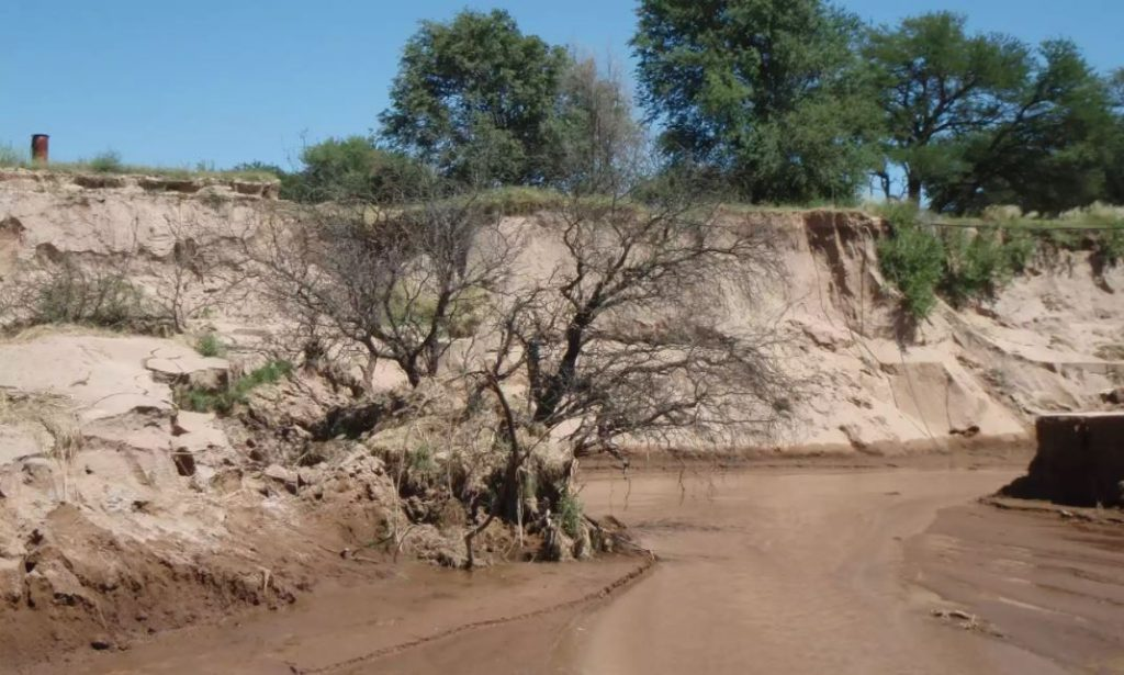 new river argentina, new river appears overnight argentina, huge new canyon river appears overnight argentina