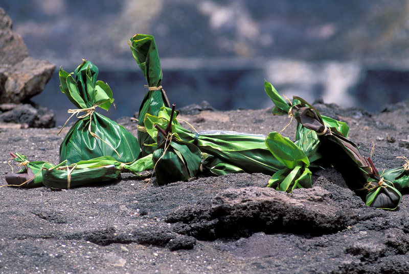 Why Hawaiians place plants before a wall of hot lava in Hawaii Offerings-ti-leaves-hawaii-volcano-eruption-1