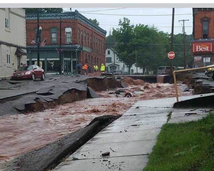 Michigan Flash Flood Wipes out Roads, Leaves Massive Sinkholes