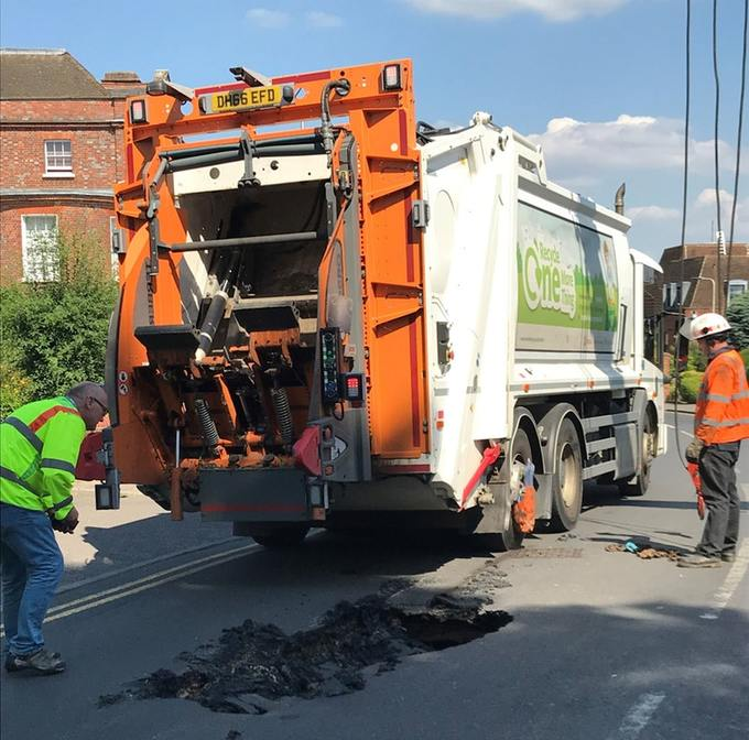heat wave melts road under garbage truck UK, heat wave melts road under garbage truck UK pictures