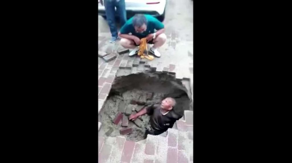 Elderly man suddenly swallowed by sinkhole that appeared with no warning beneath his feet Man-swallowed-by-sinkhole-china-july-2018-1024x573