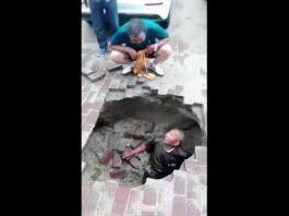 man swallowed by sinkhole china july 2018, sinkhole swallows man china video