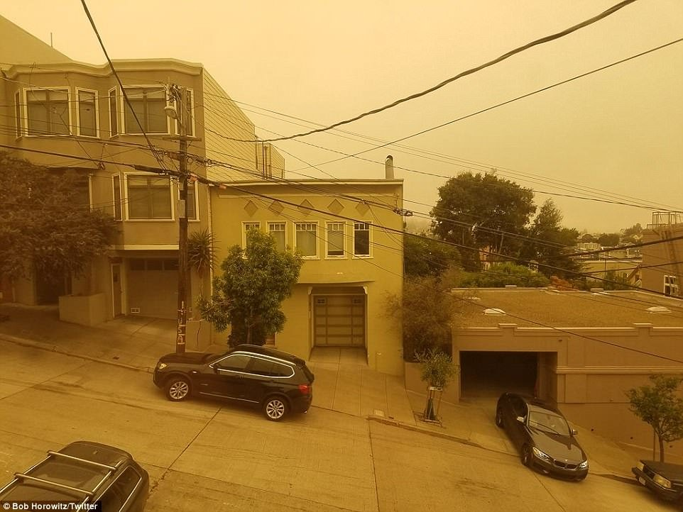 san francisco orange haze northern california wildfire 2018, san francisco orange haze northern california wildfire 2018 pictures, san francisco orange haze northern california wildfire 2018 video, Eerie orange haze covers San Francisco's sky as terrifying photos show raging wildfires spread across Northern California