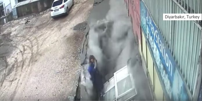 women swallowed by sinkhole turkey video, women swallowed by sinkhole turkey, women swallowed by sinkhole in pavement turkey