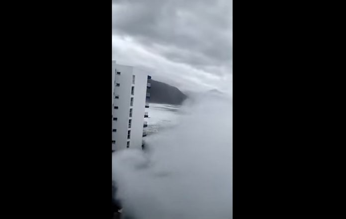 giant waves tenerife video, Giant waves engulfs coastal Tenerife in terrifying videos