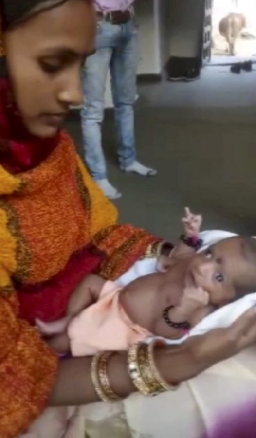 A baby girl born with three hands is now worshipped as a god in India, A baby girl born with three hands is now worshipped as a god in India pictures, A baby girl born with three hands is now worshipped as a god in India video, A baby girl born with three hands is now worshipped as a god in India november 2018, A baby girl born with three hands is now worshipped as a god in India december 2018