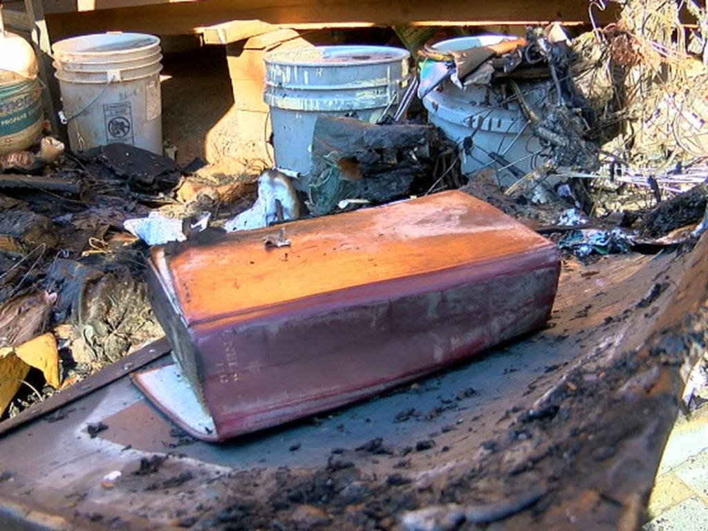 Man finds Bible unscathed after fire destroys tiny home