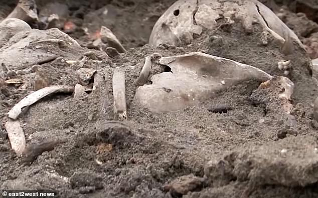 Mass grave containing 1,000 executed Jewish men, women and children is uncovered on the site of WWII Belarus ghetto where 28,000 were killed by the Nazis