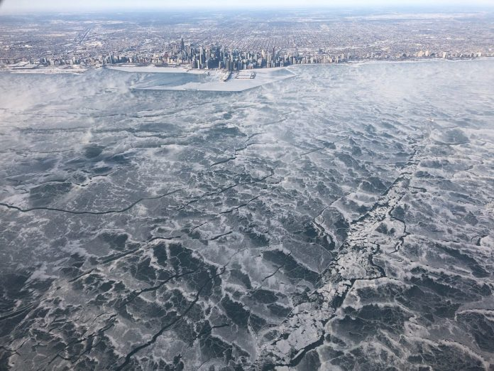 lake michigan frozen, frozen lake michigan, lake michigan freezes during polar vortex