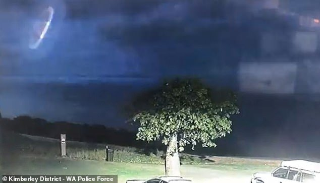 'We may not be alone': Police release eerie footage of a UFO-like object hovering in the sky during an intense thunderstorm in Australia's remote northwest