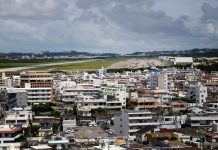 A view of Marine Corps Air Station Futenma, which is next to a residential area and has been at the center of controversy in Okinawa over claims of water contamination, okinawa water contamination pfas, drinking water contamination us army okinawa japan