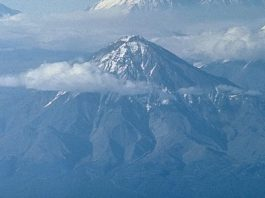 Extinct volcano has woken up and scientists say it could erupt 'at any moment' in a Pompeii-like explosion, russian volcano bolshaya udina active again