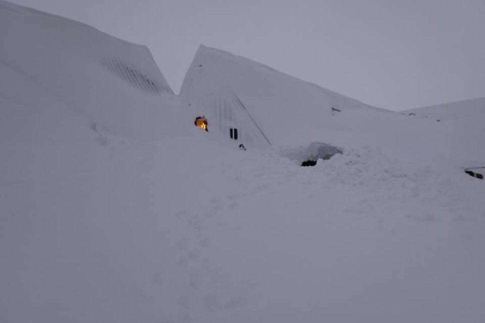 Two-story building buried under snow in Iceland, Two-story building buried under snow in Iceland video, Two-story building buried under snow in Iceland picture