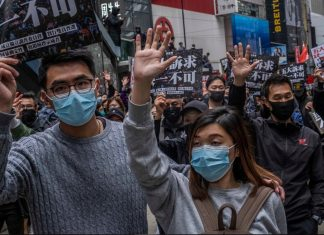 mystery viral outbreak hong kong, biological weapon attack hong kong, hong kong protests 2020,Hong Kong protesters wearing masks in January 2020
