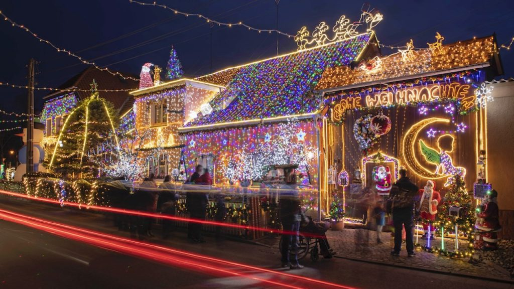 Social media trend has people putting up Christmas lights to spread cheer during viral pandemic