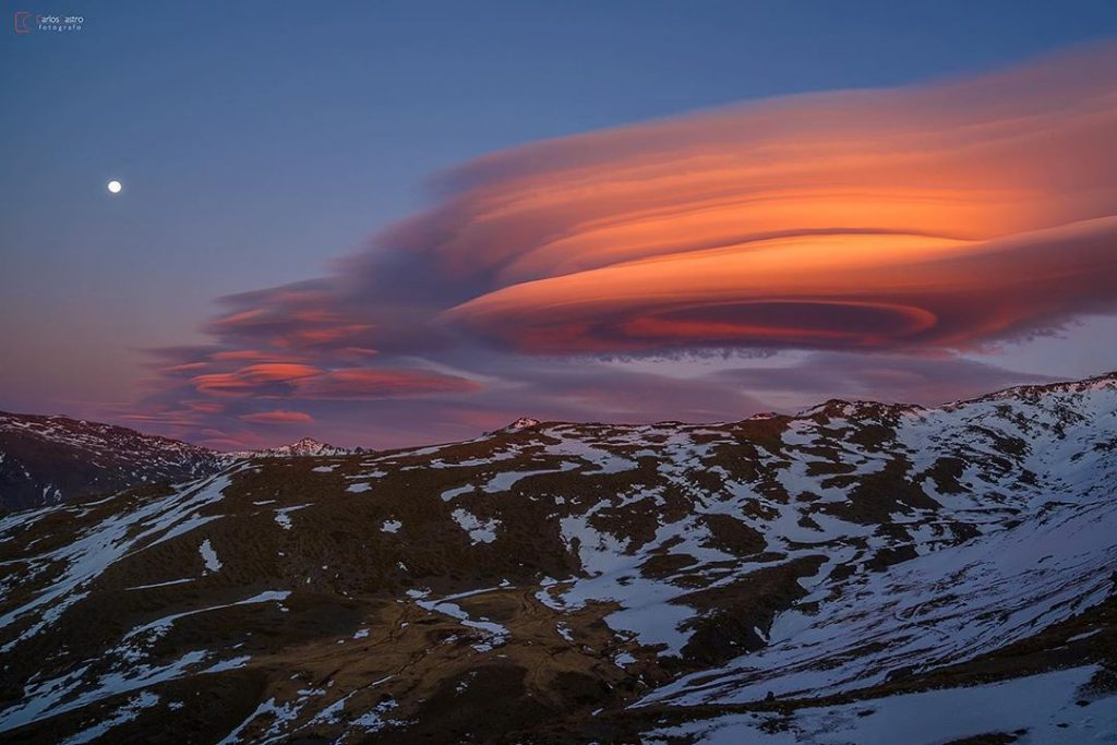 Gigantic lenticular clouds hover over Granada Spain on March 8 2020, Gigantic lenticular clouds hover over Granada Spain on March 8 2020 pictures, Gigantic lenticular clouds hover over Granada Spain on March 8 2020 video