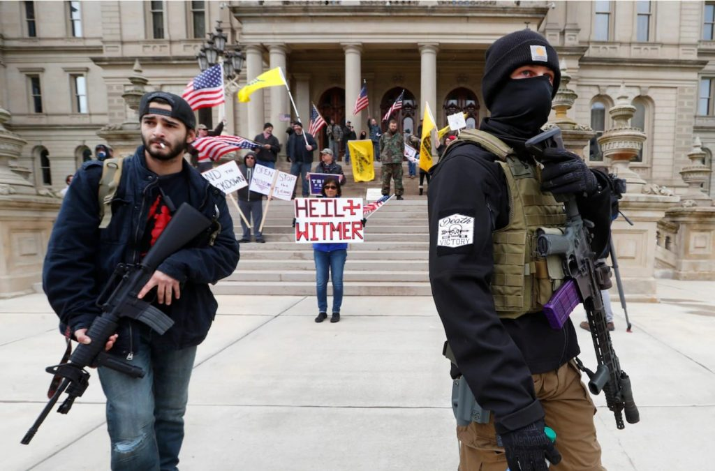 coronavirus protests usa, Protesters carry rifles near the steps of the Michigan State Capitol as they voiced opposition to the state's lockdown coronavirus protests usa video, coronavirus protests usa pictures,
