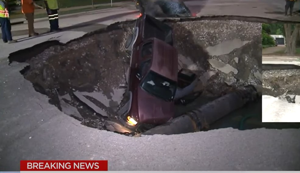 Driver crashes his truck into massive sinkhole in St. Louis, giant sinkhole truck st louis