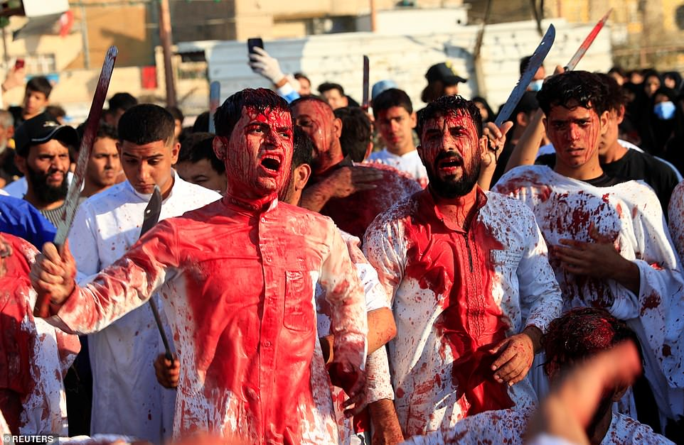Devout Shiite Muslims are left covered in blood as they flagellate themselves with swords and chains during mourning procession to mark day of Ashura in Iraqi holy city of Najaf