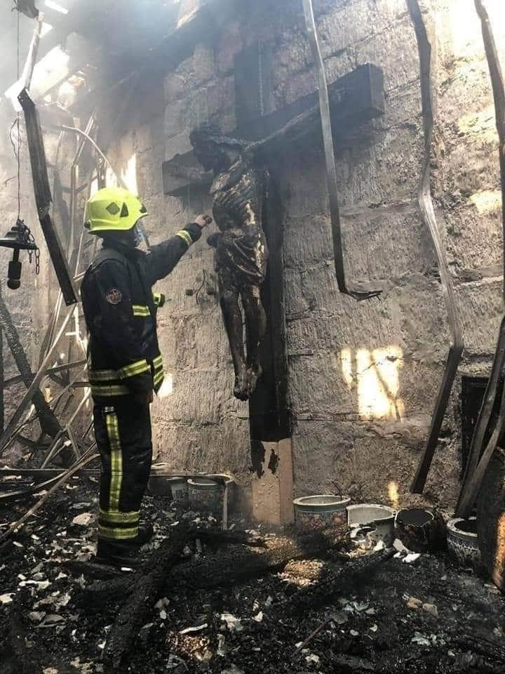 Wooden crucifix reminds intact after fire destroys church