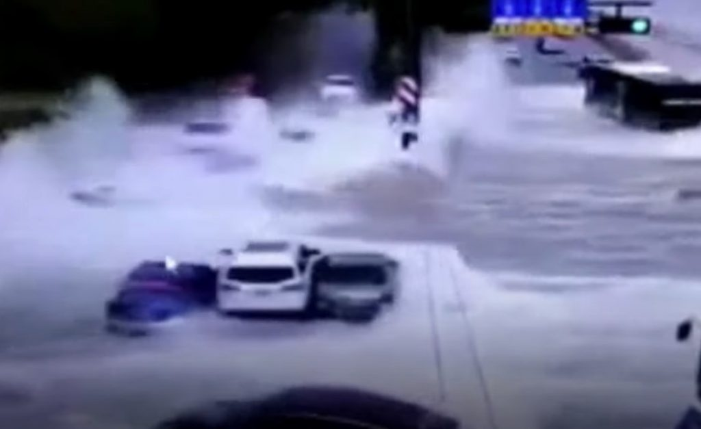 gigantic tidal wave crashes on road in china video, Monster tidal waves crash on road and sweep away vehicles in China