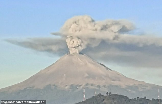 Face of Mexican 'Day of the Dead' symbol 'the Elegant Skull' appears in volcanic ash cloud weeks before the annual festival