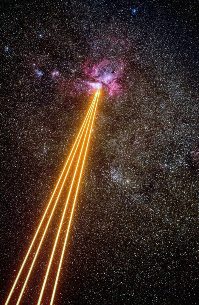 Earth is fighting a laser duel with the exploding Carina Nebula