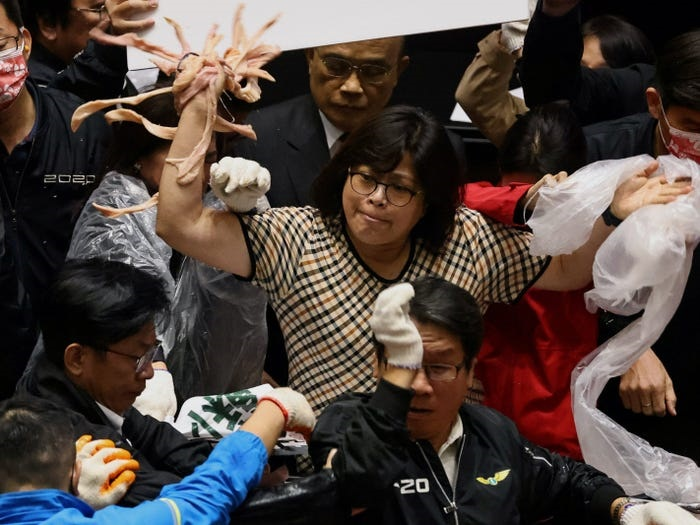Taiwan Lawmakers Brawl And Throw Pig Organs Over US Pork Imports
