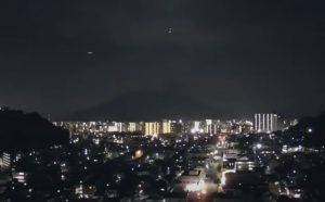 A giant ufo chased by a group of orbs over Sakurajima volcano in Japan