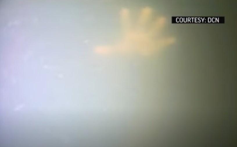 divers find man alive in sunken tugboat video