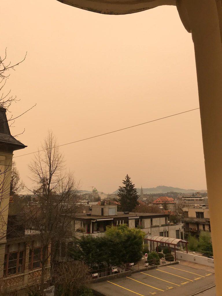 Sahara dust over Bern in Switzerland turns the sky orange, sahara dust storm europe, sahara poussières europe february 2021, poussières sahara europe france suisse italie