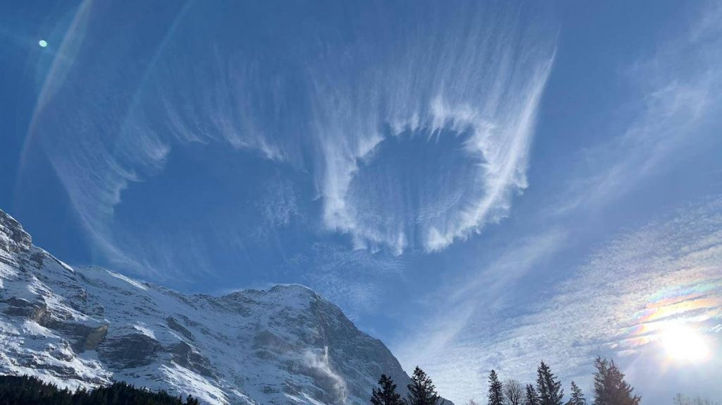 mysterious cloud circles over Swiss Alps, mysterious cloud circles over Swiss Alps pictures, mysterious cloud circles over Swiss Alps photo, mysterious cloud circles over Swiss Alps march 2021