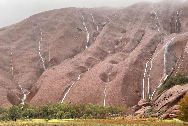 uluru waterfalls, uluru waterfalls video, uluru waterfalls pictures, Waterfalls cascade down Uluru as severe weather brings heavy rain to Nothern Territory in Australia