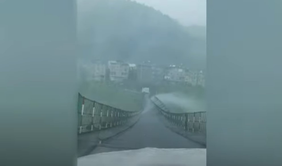 Terrifying scene as cable bridge violently swings as strong winds batter southern China, Terrifying scene as cable bridge violently swings as strong winds batter southern China video, Terrifying scene as cable bridge violently swings as strong winds batter southern China footage, Terrifying scene as cable bridge violently swings as strong winds batter southern China may 2021
