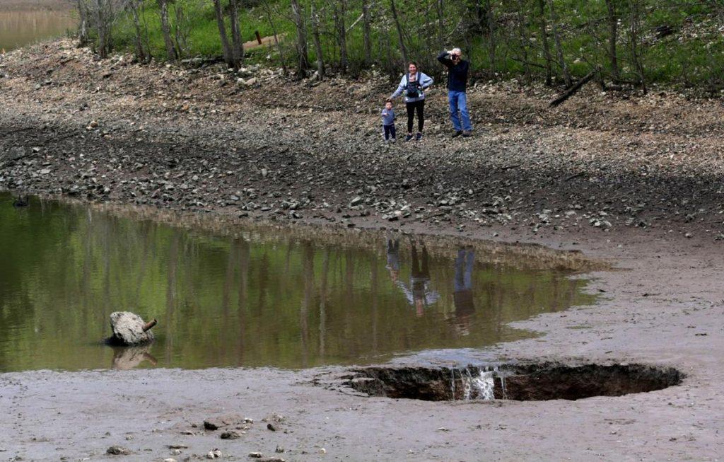 Sinkhole drains lake in Lone Elk Park near St. Louis Missouri, Sinkhole drains lake in Lone Elk Park near St. Louis Missouri video, Sinkhole drains lake in Lone Elk Park near St. Louis Missouri picture, Sinkhole drains lake in Lone Elk Park near St. Louis Missouri may 2021