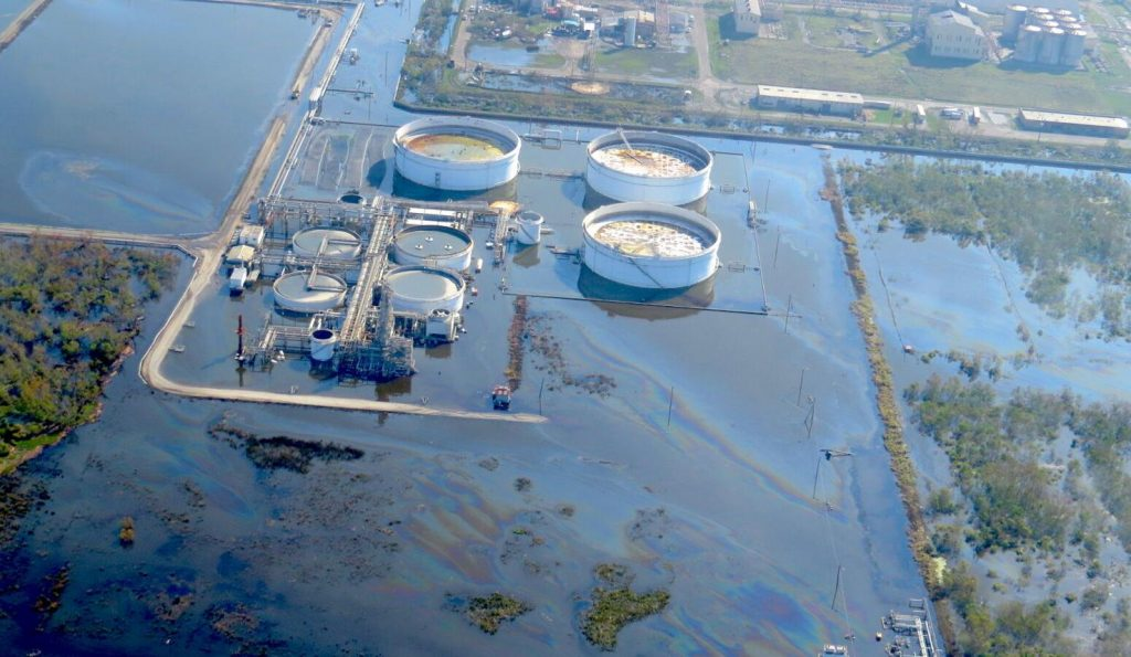 large oily sheen in the floodwaters surrounding part of the Alliance Refinery near Belle Chasse. The refinery flooded just after Hurricane Ida struck the Louisiana coast.
